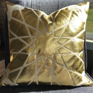 Gold metallic star design accent pillow
